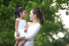 Asian Mum & daughter Stock Image