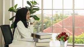 Asian muslim business woman in jihab working in office