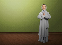 Asian muslim child with veil praying and standing Royalty Free Stock Photos