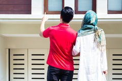 Asian Muslim couple choosing house Royalty Free Stock Photo