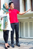 Asian Muslim couple choosing house Stock Photos