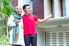 Asian Muslim couple choosing house Stock Image