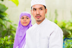 Asian Muslim couple, man and woman, praying at home Stock Photography