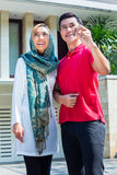 Asian Muslim couple moving into house Royalty Free Stock Photos