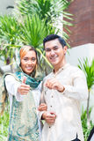 Asian Muslim couple moving into house Stock Photos