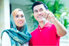 Asian Muslim couple moving into house Stock Photography