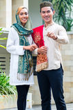 Asian Muslim couple wearing traditional dress Stock Images