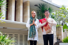 Asian Muslim couple wearing traditional dress Stock Photography