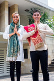 Asian Muslim couple wearing traditional dress Stock Photos