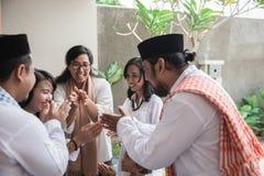 Family forgiving and apologizing each other. eid mubarak. Asian muslim family during eid mubarak celebration. forgiving and apologizing each other royalty free stock image