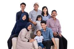 Asian muslim family eid mubarak ramadan kareem. Celebration isolated over white background royalty free stock photography