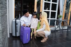 Asian muslim family with suitcase royalty free stock photography