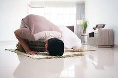 muslim husband and wife praying jamaah together at home