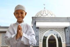 Asian muslim kid. Greeting and smiling Stock Photos