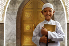 Asian muslim kid. Holding koran stock image