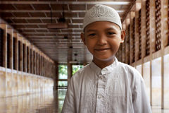 Asian muslim kid. In mosque Stock Images
