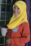 Asian Muslim Lady with coffee mug Stock Photos