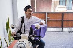 Muslim male travelling for eid mubarak lebaran by motorcyle. Asian muslim male travelling for eid mubarak lebaran by motorcyle. mudik balik kampung concept by royalty free stock images