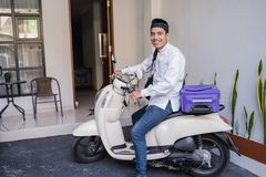 Muslim male travelling for eid mubarak lebaran by motorcyle. Asian muslim male travelling for eid mubarak lebaran by motorcyle. mudik balik kampung concept by stock photography