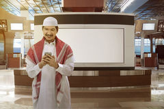 Asian muslim man holding phone Stock Photography
