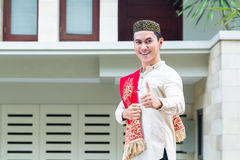 Asian Muslim man wearing traditional dress stock photo
