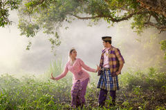 Asian Muslim man and woman wearing traditional dress Royalty Free Stock Images