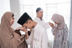 Asian muslim parent shake hand in idul fitri eid mubarak