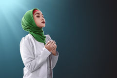 Asian muslim woman praying. Image of beautiful asian muslim woman praying Royalty Free Stock Photography