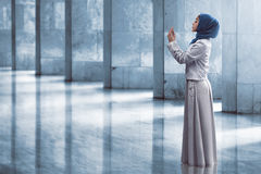 Asian muslim woman praying. Image of beautiful asian muslim woman praying Stock Photo