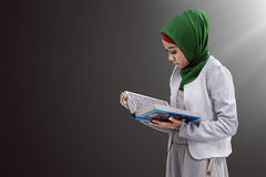 Asian muslim woman reading koran Royalty Free Stock Images