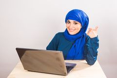 Asian muslim woman working with computer. Asian muslim woman working with computer laptop Royalty Free Stock Images
