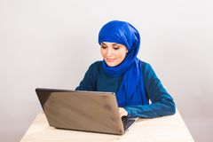 Asian muslim woman working with computer. stock photos