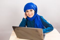 Asian muslim woman working with computer. Asian muslim woman working with computer laptop Royalty Free Stock Photo
