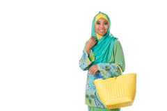 Asian muslimah woman with yellow wicker tote bag.Isolated.Copyspace Stock Images