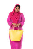 Asian muslimah woman with yellow wicker tote bag.Isolated Royalty Free Stock Images