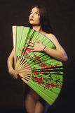 Asian naked girl with big fan Royalty Free Stock Image