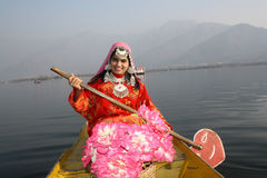 Asian Native Girl rowing a Boat. Very beautiful Kashmir girl in 20s rowing a Shikara boat on Dal Lake, Kashmir Stock Photos