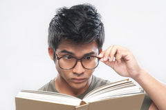 Asian Nerd Studying holding glasses Stock Images