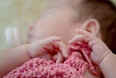 Asian new born baby`s hand. Close up of asian new born baby`s hand Royalty Free Stock Images