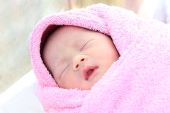 Asian new born infant sleep. In towel Stock Images