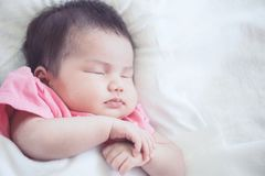 Asian newborn baby girl sleeping Royalty Free Stock Images
