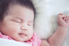 Asian newborn baby girl sleeping Royalty Free Stock Photo