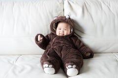 Asian newborn baby wearing bear suit Royalty Free Stock Image