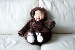 Asian newborn baby wearing bear suit Royalty Free Stock Photo