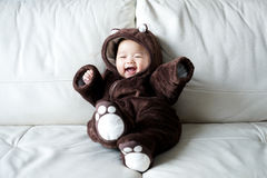 Asian newborn baby wearing bear suit Royalty Free Stock Photography