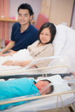 Asian Newborn and parents Stock Images