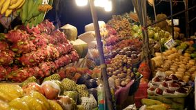 Asian Night Food Market with Exotic Fruits and Vegetables. Thailand. Jomtien, Pattaya. Tourists choose food on the counter stock footage