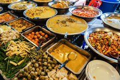 Asian night food market. Prepared cooked dishes. Asian night food market. Prepared cooked ready to eat take away dishes Stock Image