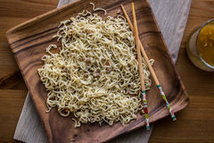 Asian Noodle with Chopsticks in a wooden plate with Beverage. Royalty Free Stock Photography