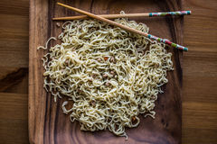 Asian Noodle with Chopsticks in a wooden plate. Royalty Free Stock Photography